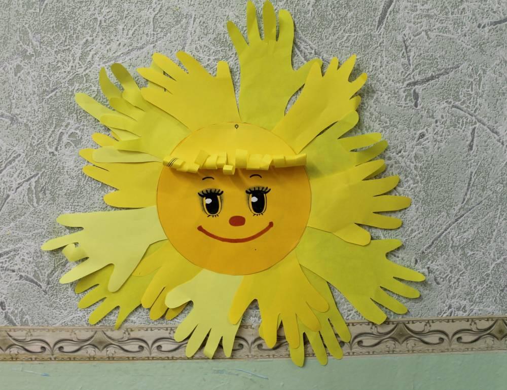 Поделки солнце в руках 289